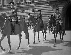 File photo dated 12/6/1947 of Princess Elizabeth rides side-saddle behind her the father, The King, at her first Trooping of the Colour since she was made Colonel of the Grenadier Guards. The military parade has marked the official birthday of the sovereign for more than 270 years.