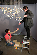 Artists Inge Panneels & Minako Shirakura hang their installation piece, involving 400 paper stars, written on by people from around the world.The work 'Wanderers of the Earth: the Milky Way Above (2014-ongoing)' was originally exhibited in Dove Cottage as part of a project about the 'Walking Poets' William Wordsworth and Matsuo Bashō.