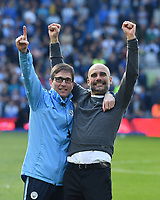 BRIGHTON, ENGLAND - MAY 12:  Manchester City manager Pep Guardiola celebrates winning the Premier League title at full time with his team mates during the Premier League match between Brighton & Hove Albion and Manchester City at American Express Community Stadium on May 12, 2019 in Brighton, United Kingdom. (MB Media)