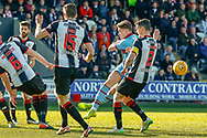 John O'Sullivan of Dundee FC tries to fire through a crowded penalty box during the Ladbrokes Scottish Premiership match between St Mirren and Dundee at the Paisley 2021 Stadium, St Mirren, Scotland on 30 March 2019.