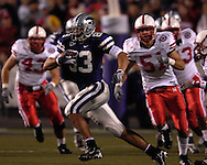 Kansas State wide receiver Daniel Gonzalez (83) races past Nebraska linebacker Bo Ruud (51) at Bill Snyder Family Stadium in Manhattan, Kansas, October 14, 2006.  The Huskers beat the Wildcats 21-3.<br />