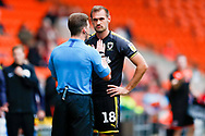 Wimbledon forward James Hanson (18) has to listen to the referee during the EFL Sky Bet League 1 match between Blackpool and AFC Wimbledon at Bloomfield Road, Blackpool, England on 20 October 2018.