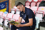 AFC Wimbledon defender Tyler Garratt (12) prior to kick off during the EFL Carabao Cup 2nd round match between AFC Wimbledon and West Ham United at the Cherry Red Records Stadium, Kingston, England on 28 August 2018.