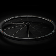 A sleek and modern bike wheel shot in a sympathetic style to create a dark, sleek image in line with the brand guidelines.
