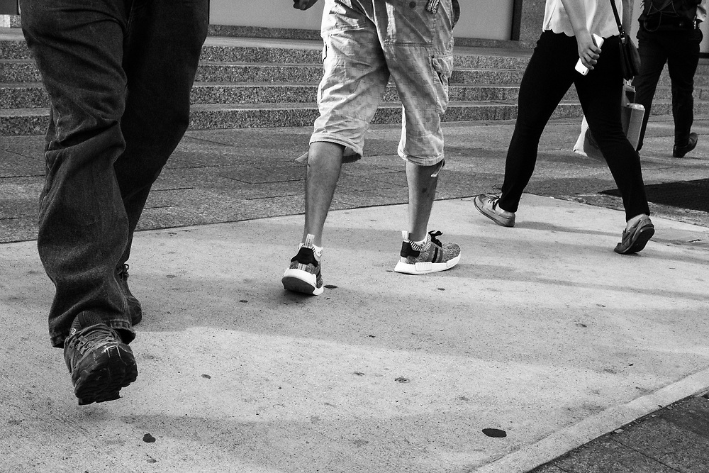 Foot Traffic is a photographic series about legs and feet in motion and at rest on the streets of Toronto.