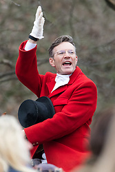 © Licensed to London News Pictures. 26/12/2018. London, UK.  The huntmaster starts the traditional Chiddingfold, Leconfield and Cowdray Boxing Day Hunt as it sets off from the kennels at Petworth House in Petworth Park, West Sussex.  Photo credit: Vickie Flores/LNP