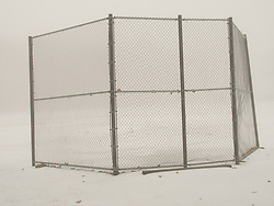 A backstop and a snow covered baseball field. East Bangor, Pennsylvania.