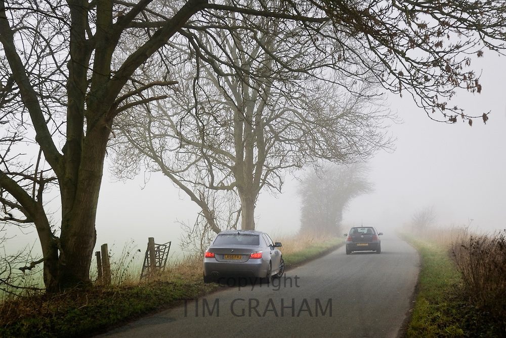 Cars on a country road, Gloucestershire, United Kingdom.
