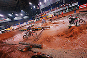 Racers splashing through water obstacle at the 2007 Maxxis AMA Endurocross at Lazy E Arena in Guthrie, Oklahoma.