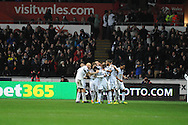 Nathan Dyer of Swansea City celebrates his late first half goal with his team mates.<br /> Barclays Premier League match, Swansea city v Newcastle Utd at the Liberty stadium in Swansea, South Wales on Wednesday 4th Dec 2013. pic by Phil Rees, Andrew Orchard sports photography,