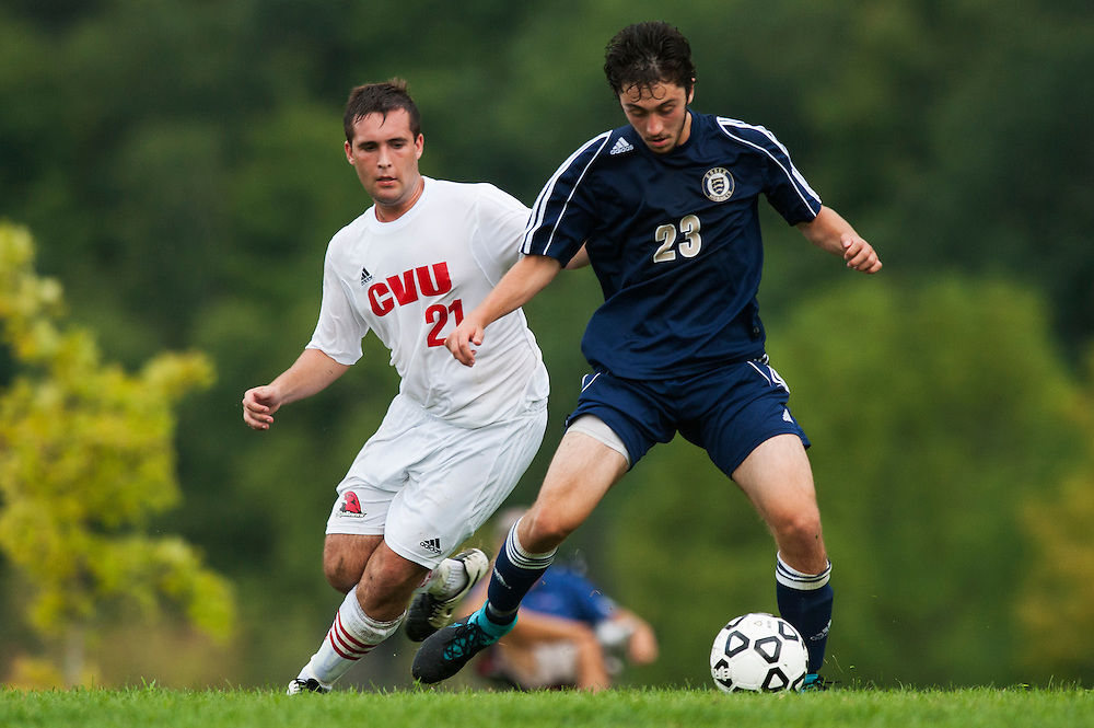 CVU's Will Yakibuk (21) battles for the ball with Essex's Brennan Goodrich (23) during the boys varsity soccer game between the Essex Hornets and the Champlain Valley Union Redhawks at CVU High School on Wednesday afternoon September 9, 2015 in Hinesburg. (BRIAN JENKINS/for the FREE PRESS)