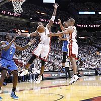 19 June 2012: Oklahoma City Thunder point guard Russell Westbrook (0) passes the ball to Oklahoma City Thunder center Kendrick Perkins (5) between Miami Heat power forward Chris Bosh (1) and Miami Heat small forward Shane Battier (31) during the Miami Heat 104-98 victory over the Oklahoma City Thunder, in Game 4 of the 2012 NBA Finals, at the AmericanAirlinesArena, Miami, Florida, USA.