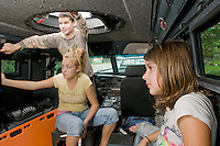 "(l-r) Madison Guyotte, Caitlin McDaniel and Ashley Olisky get a tour from Sgt. Rich Simmons from the Belknap Regional Special Operations Team of their  ""Bearcat"" SWAT vehicle on display at Laconia Rotary Park on Sunday as part of the Child Safety Day sponsored by the Laconia Rotary Club and Laconia Police and Fire Departments.  (Karen Bobotas/for the Laconia Daily Sun)"