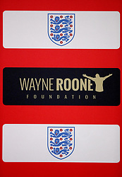 A general view of a Wayne Rooney Foundation sign during the press conference at Wembley Stadium, London.