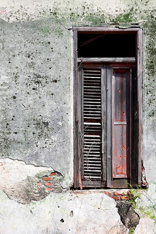 Weathered window in San Miguel de los Banos, Matanzas, Cuba.