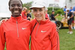 Joan Benoit Samuelson and Catherine Ndereba after race