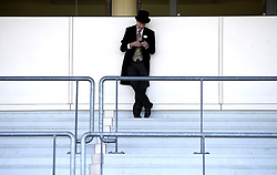 A racegoer during day four of Royal Ascot at Ascot Racecourse.