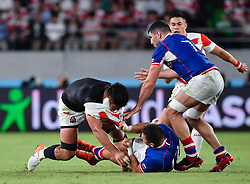 Japan's Kazuki Himeno is tackled by Russia's Dmitry Gerasimov and Tagir Gadzhiev during the Pool A match between Japan and Russia at the Tokyo Stadium, Tokyo, Japan. Picture date: Friday September 20, 2019. See PA story RUGBYU Japan. Photo credit should read: Ashley Western/PA Wire. RESTRICTIONS: Editorial use only. Strictly no commercial use or association. Still image use only. Use implies acceptance of RWC 2019 T&Cs (in particular Section 5 of RWC 2019 T&Cs) at: https://bit.ly/2knOId6