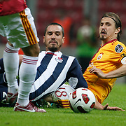 Galatasaray's Ayhan AKMAN (R) during their Turkish Super League soccer match Galatasaray between Kasimpasaspor at the TT Arena at Seyrantepe in Istanbul Turkey on Monday 09 May 2011. Photo by TURKPIX