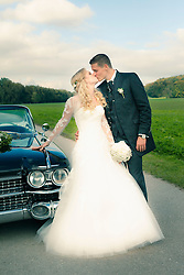 Newlywed couple kissing next to car, Ammersee, Upper Bavaria, Bavaria, Germany