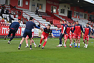 Stevenage defender Ben Coker(3)  and team mates warming up during the EFL Sky Bet League 2 match between Stevenage and Cheltenham Town at the Lamex Stadium, Stevenage, England on 20 April 2021.