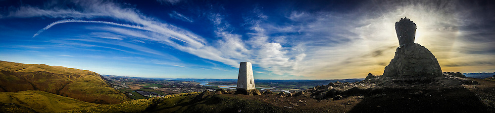 Pic at the top of Dumyat, a hill at the western extremity of the Ochil Hills in central Scotland, showing the trig point and the characteristic cairn.