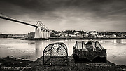 Beginning of a new day at Afon Menai. Morning light splashes over the beautiful suspension bridge and the sleeping town of Menai Bridge. Always something wonderful about early morning and the promise of hope and things to come.