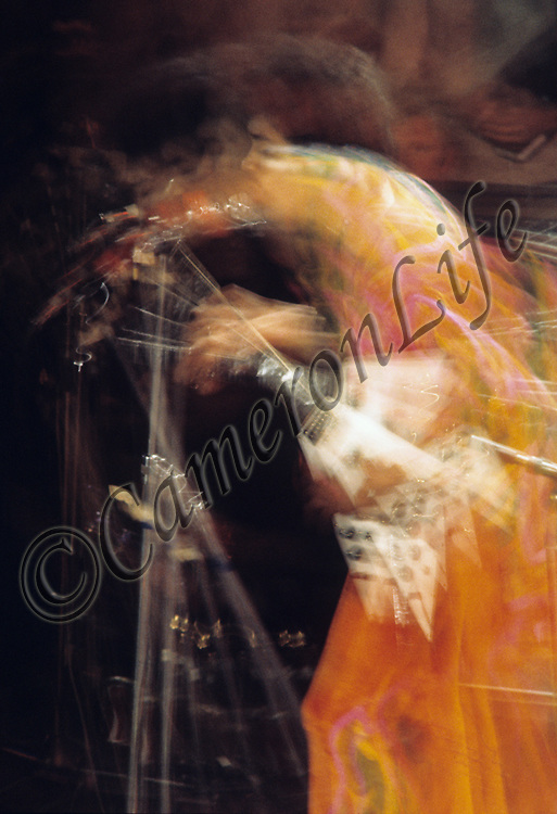"""Jimi Hendrix - blurrr.-.In this photograph Charles Everest has succeeded to convey the energy and motion of one of the world's greatest ever guitar players.  .By tracking his movements on stage, and anticipating Jimi's signature gestures, the motion-blur effect was a deliberate and conscious act which sets this image apart from the others captured that evening..In the context of this exhibition, he could almost be morphing into Guy Portelli's sculpture """"Hey Joe"""" which was also on display in the exhibition!"""