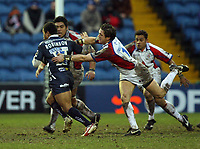 Photo: Rich Eaton.<br /> <br /> Sale Sharks v Bristol Rugby. Guinness Premiership. 01/01/2007. Jason Robinson #15 of Sale is tackled by Sam Cox of Bristol