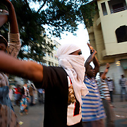 February 23, 2012 - Dakar, Senegal: A opposition supporter throws a stone towards the a police during a protest against the candidature of the current president Abdoulaye Wade for a anti-constitutional third candidature to as head of state. Tensions between police and opposition supporters have been high in the capital Dakar and other cities around the country, where some clashes have happen ahead of the presidential elections on the 26th of February. At least fourteen people have died in the past month. (Paulo Nunes dos Santos/Polaris)