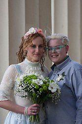 © Licensed to London News Pictures. 29/03/2014. Brighton, United Kingdom. Nikki Pettit and Tania Ward at Brighton town hall after getting married. they were one of five couples getting married in Brighton on the day gay marriage became legal. Photo credit : Hugo Michiels