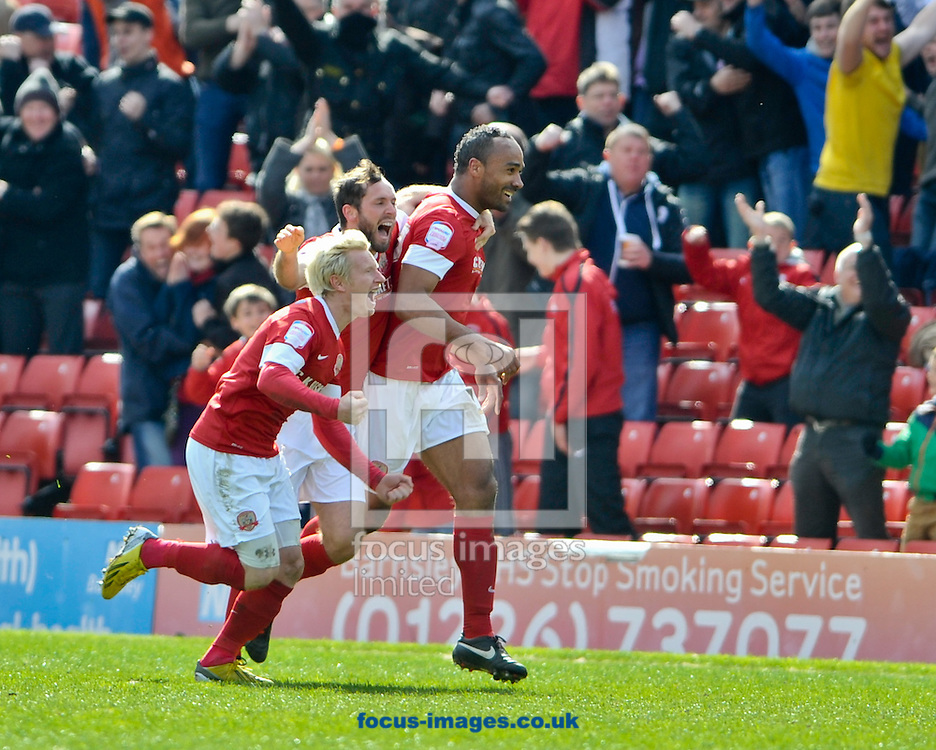 Picture by Richard Land/Focus Images Ltd +44 7713 507003.27/04/2013.Chris O'Grady (R) of Barnsley runs to the bench to celebrate making it 2-0 during the npower Championship match at Oakwell, Barnsley.