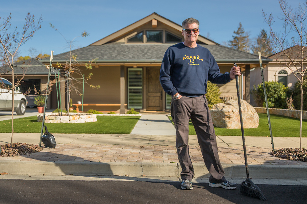 """""""I work for the government.  I go back to work tomorrow and I'm a little bit nervous.  The work has really piled up and I'm not sure what we'll find.   -Brad Darfler sweeps up in front of his house before heading back to San Francisco."""