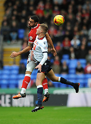 Josh Vela of Bolton Wanderers challenges for the header with Derrick Williams of Bristol City - Mandatory byline: Dougie Allward/JMP - 07966 386802 - 07/11/2015 - FOOTBALL - Macron Stadium - Bolton, England - Bolton Wanderers v Bristol City - Sky Bet Championship