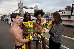 © licensed to London News Pictures. London, UK 15/02/2012. Waiters of Cantina Del Ponte handing out Prosseco and flowers along River Thames to increase awareness to International Women's Day at Tower Bridge, London. Photo credit: Tolga Akmen/LNP