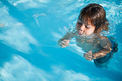 Little boy swimming in the pool, Mauritius