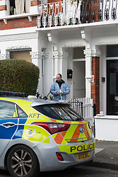 A forensic investigator enters a victorian terrace home after a 'small, contained' fire in Burnfoot Avenue, Fulham, claimed the life of a woman. Fulham, London. February 07 2018.