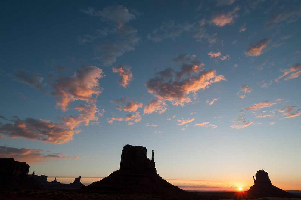 The sun rises at Monument Valley