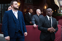 London, UK. 12 July, 2019. Unmarked security guards stand outside 5 Hertford Street in Mayfair, which also houses exclusive private club Loulou's, during a protest to call for the living wage for its kitchen workers who were recently outsourced through ACT Clean by members of the Cleaners and Facilities Branch of the IWGB (Independent Workers of Great Britain) trade union.