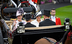 © Licensed to London News Pictures. 19/06/2018. London, UK.  Meghan, Duchess of Sussex Sophie, Countess of Wessex, Prince Edward and Prince Harry arrive for Day one of Royal Ascot at Ascot racecourse in Berkshire, on June 19, 2018. The 5 day showcase event, which is one of the highlights of the racing calendar, has been held at the famous Berkshire course since 1711 and tradition is a hallmark of the meeting. Top hats and tails remain compulsory in parts of the course. Photo credit: Ben Cawthra/LNP