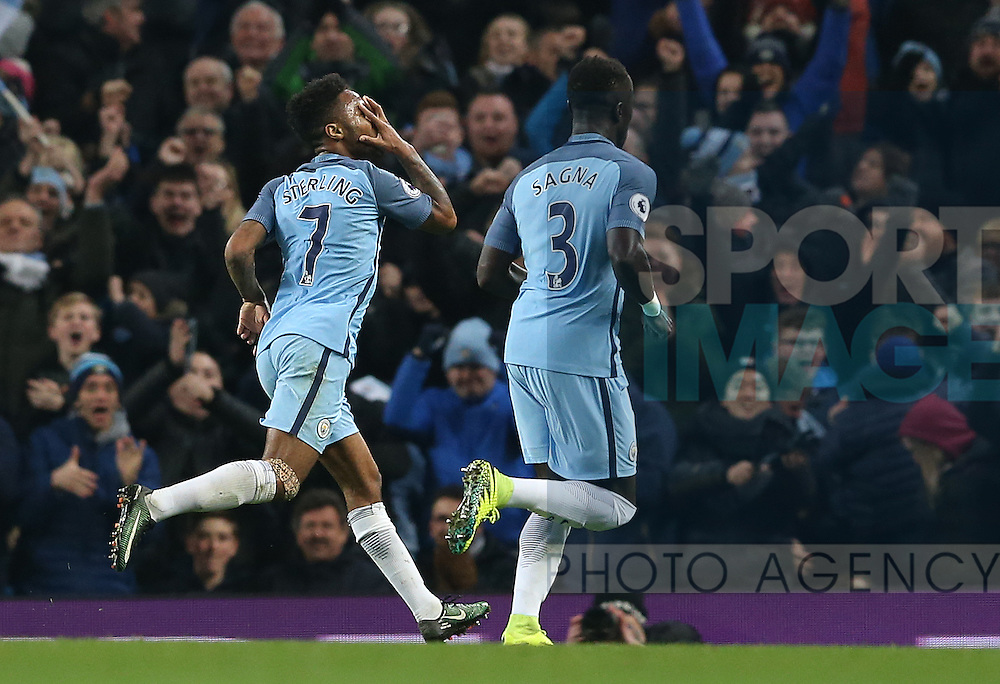 Raheem Sterling of Manchester City (l) celebrates scoring their second goal during the English Premier League match at the Etihad Stadium, Manchester. Picture date: December 18th, 2016. Picture credit should read: Simon Bellis/Sportimage