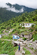 A woman walks home after collecting water in Subhai village, Uttarakhand, Central Himalayas, India.