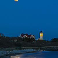 New England photography of the pink full moon over Nobska Lighthouse and lighthouse beach. This iconic Massachusetts Cape Cod lighthouse is located near Woods Hole Village in Falmouth, MA on the Cape.<br /> <br /> Beautiful Massachusetts lighthouse photography images are available as museum quality photography prints, canvas prints, acrylic prints, wood prints or metal prints. Fine art prints may be framed and matted to the individual liking and interior design decorating needs:<br /> <br /> https://juergen-roth.pixels.com/featured/full-moon-over-nobska-lighthouse-juergen-roth.html<br /> <br /> Good light and happy photo making!<br /> <br /> My best,<br /> <br /> Juergen