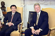 US President Bill Clinton with Chinese Premier Zhu Rongji in the Oval Office at the White House April 8, 1999 in Washington D.C.