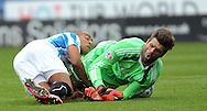 James Vaughn of Huddersfield Town collides with  Dimitros Konstanopollos of Middlesbrough during the Sky Bet Championship match at the John Smiths Stadium, Huddersfield<br /> Picture by Graham Crowther/Focus Images Ltd +44 7763 140036<br /> 13/09/2014