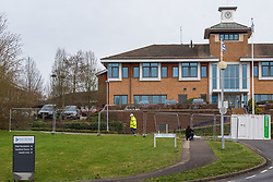 © Licensed to London News Pictures. 08/02/2020. Milton Keynes, UK. Contractors install perimeter fencing across the entrance to the Kents Hill Park Training and Conference Centre. A Milton Keynes conference centre is to house evacuees from the Chinese city of Wuhan, the epicentre of the Novel Coronavirus (2019-nCoV) outbreak, the British citizens are due to be flown back on Sunday 9th February and are expected to land at RAF Brize Norton in Oxfordshire and will remain at the conference centre for 14 days to be monitored. Photo credit: Peter Manning/LNP