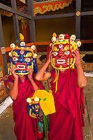 Novice monks with mask, Paro Dzong Monastery Fortress, Paro Valley, Bhutan