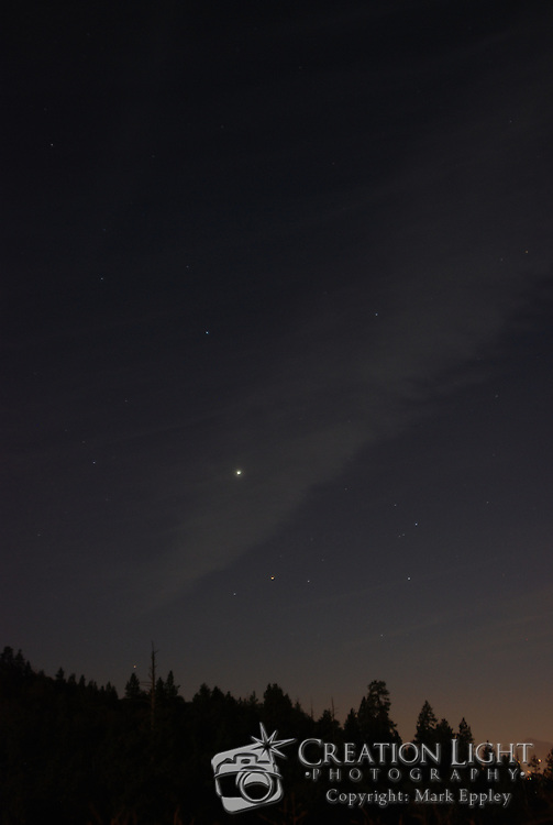 Night Sky in Medford, Oregon. Just after sunset, the stars are visible even through a thin cloud in the sky.