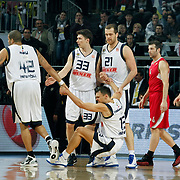 Fenerbahce Ulker's Marko TOMAS (2ndL), Sarunas JASIKEVICIUS (F), Oguz SAVAS (C) and Olympiacos's Vassilis SPANOULIS (R), Theodoros PAPALOUKAS (2ndR) during their Euroleague Basketball Top 16 Game 5 match Fenerbahce Ulker between Olympiacos at Sinan Erdem Arena in Istanbul, Turkey, Thursday, February 24, 2011. Photo by TURKPIX