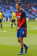 Crystal Palace defender Scott Dann (6) warms up prior to the Premier League match between Crystal Palace and Huddersfield Town at Selhurst Park, London, England on 30 March 2019.